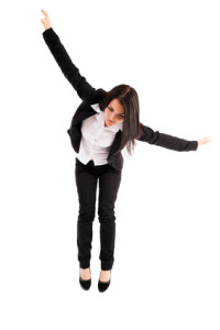 Young businesswoman falling down