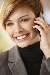 Attractive young woman talking on mobile phone